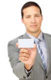 Composed young businessman holding a white card Stock Image