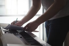 Free Composer And Songwriter Writing Notes Or Lyrics On Paper Stock Image - 103769061