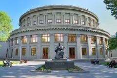 Composer Aram Khachaturian's statue, Yerevan, Armenia. YEREVAN, ARMENIA - MAY 02, 2015: State Academic Opera and Ballet Theater of Armenia. Composer Aram royalty free stock photo