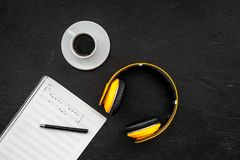 Composer and song writer desktop with headphones and notes on black background top view mock up. Composer and song writer desktop with headphones and notes on Stock Images