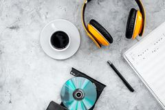 Composer and song writer desktop with headphones and notes on stone background top view mock up. Composer and song writer desktop with headphones and notes on Royalty Free Stock Photos