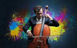 Composer with splotch and his cello. Young classical musician with colorful splotch wallpaper stock image