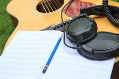Composer write note of song and use acoustic guitar. For play in the park stock photos