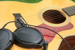 Composer write note of song. And use acoustic guitar for play stock photos