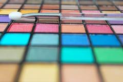 Composez la palette et l'applicateur image stock