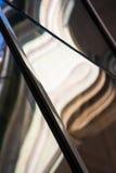 Composição abstrata com os detalhes do vidro e da arquitetura refletidos e distorcidos Imagens de Stock Royalty Free