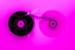 Composição abstrata dos carretéis de fita video do sistema home VHS no efeito cor-de-rosa da cor fotografia de stock royalty free