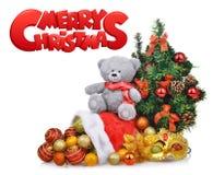 A composição com a árvore de Natal do urso de peluche e Papai Noel ensacam Fotografia de Stock