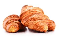 Composição com os croissant isolados no branco Imagem de Stock