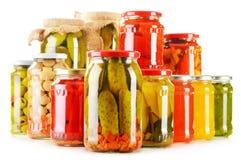 Composição com os frascos de vegetais conservados Alimento psto de conserva Fotografia de Stock