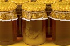 Composição com os frascos do mel Imagem de Stock Royalty Free