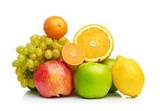 Composição com os frutos isolados em um branco Fotografia de Stock