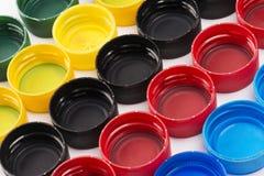 Composição com os tampões de garrafa plásticos Imagem de Stock Royalty Free