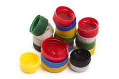 Composição com os tampões de garrafa plásticos Imagens de Stock