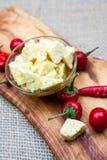 A composição com queijo remenda no azeite e nos pimentos Imagens de Stock Royalty Free