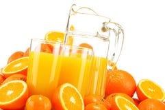 Composição com vidros do suco de laranja e dos frutos Fotografia de Stock