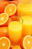 Composição com vidros do suco de laranja e dos frutos Foto de Stock