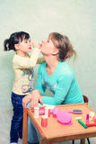 Composição do jogo Mamã e filha Fotos de Stock Royalty Free