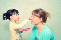Composição do jogo Mamã e filha Foto de Stock