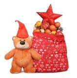 A composição do Natal com saco de Papai Noel e o urso de peluche brincam Foto de Stock