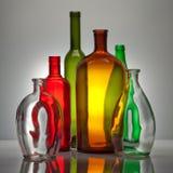 Composição dos frascos de vidro da cor Fotografia de Stock Royalty Free