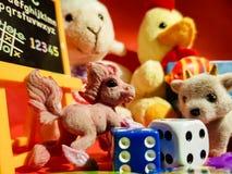 Composição dos jogos pequenos que fariam cada criança feliz Fotografia de Stock Royalty Free