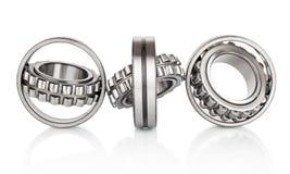 Composição dos rolamentos de rolo da bola de aço no close up isolado no branco Imagem de Stock Royalty Free