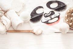 Composição dos termas com máscara facial, conceito da beleza e saúde imagem de stock