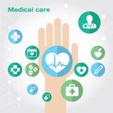 Composição lisa do ícone dos cuidados médicos com mão Fotos de Stock Royalty Free