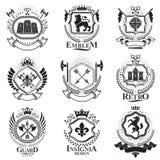 Composições decorativas dos emblemas do vintage, vetores heráldicos classe ilustração stock