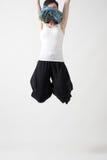 Composición abstracta conceptual de saltar de la mujer joven del pelo corto del marco Fotografía de archivo libre de regalías