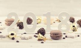Composición con el número 2018 como símbolo del Año Nuevo que viene Imagenes de archivo