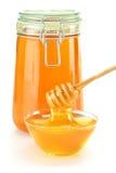 Composición con el plato de la miel y del palillo Fotografía de archivo libre de regalías