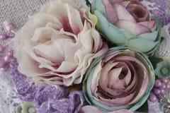 Composición con las flores de la tela Foto de archivo