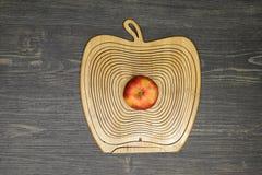 Composición con una manzana Fotos de archivo
