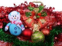 Composición de la Navidad con el muñeco de nieve y la decoración Imagen de archivo