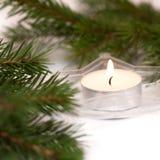 Composición de la Navidad con las ramas de la vela y del abeto Imagen de archivo