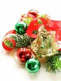 Composición de la Navidad con las ramas y la campana del abeto Foto de archivo