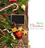 Composición de la Navidad con una pequeña pizarra fotografía de archivo libre de regalías