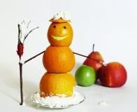 Composición de la Navidad del friut anaranjado del muñeco de nieve Fotos de archivo