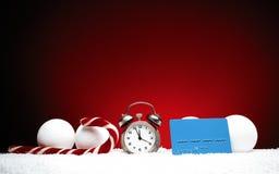Composición de la Navidad Tarjeta de felicitación para los vagos del despertador del Año Nuevo Foto de archivo libre de regalías
