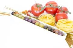 Composición de las pastas y de los tomates Imagen de archivo