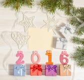 Composición de los números 2016 y de las cajas de regalo Imagen de archivo libre de regalías