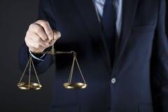 Composición de los símbolos de la ley y de la justicia Foto de archivo libre de regalías