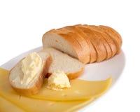 Composición de pan blanco y de la mantequilla Foto de archivo libre de regalías