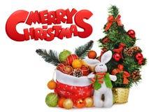Composición del Año Nuevo con el bolso y los juguetes de Papá Noel del árbol de navidad Foto de archivo libre de regalías
