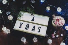 Composición del invierno - tablero ligero con Navidad del texto Fotos de archivo libres de regalías