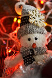 Composición del ` s del Año Nuevo de un muñeco de nieve y de luces Fotos de archivo libres de regalías