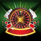 Composición oro-enmarcada casino con la rueda de ruleta Imágenes de archivo libres de regalías