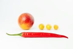 Composición, pimienta roja y fruta Imagen de archivo libre de regalías